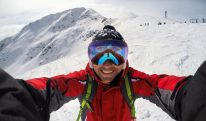 Selfie of cheerful skier on the top of the mountain